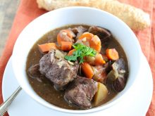 This Slow Cooker Beef Stew Recipe is a delicious and cozy meal to come home to on a winter evening. Brown ale gives the broth a delicious, rich flavor! l www.littlechefbigappetite.com