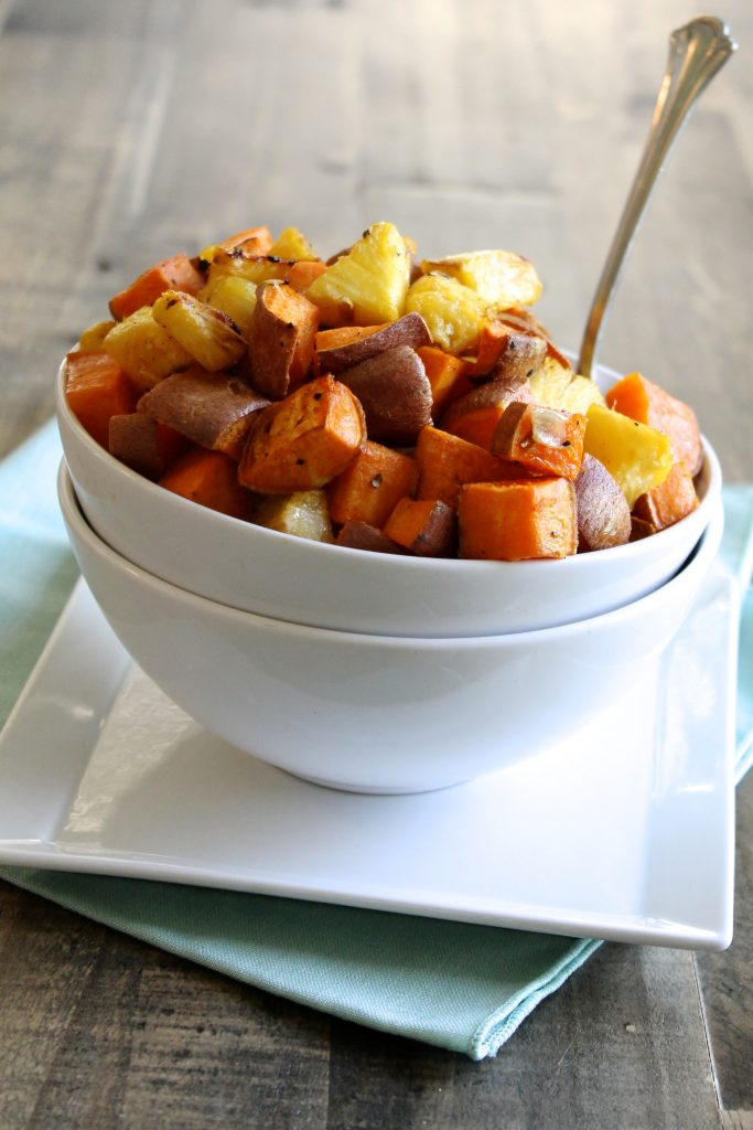 This Roasted Pineapple and Sweet Potato is a delicious side dish to pair with almost anything! It's a simple recipe with less than five ingredients, plus it's gluten-free, dairy-free, refined sugar-free, and vegan! ll www.littlechefbigappetite.com