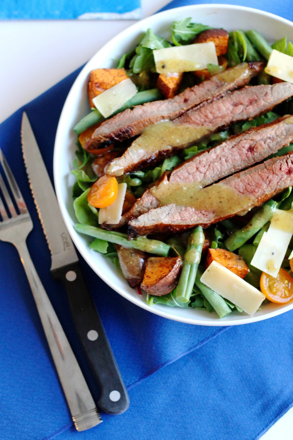 Skirt Steak Salad with Roasted Sweet Potatoes, Tomatoes, Green Beans, and Shaved Parmesan Recipe ll A hearty and gluten-free salad recipe! ll www.littlechefbigappetite.com