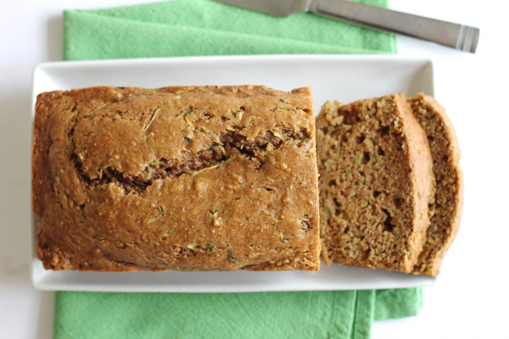 This healthy Whole Wheat Zucchini Bread is a great way to sneak whole grains and vegetables into a treat. It's low in fat and much better for you than the traditional recipe. The whole family will love it. // www.littlechefbigappetite.com // Healthy Zucchini Bread, Healthy Bread Recipe, Whole Wheat Bread Recipe, Zucchini Bread Recipe