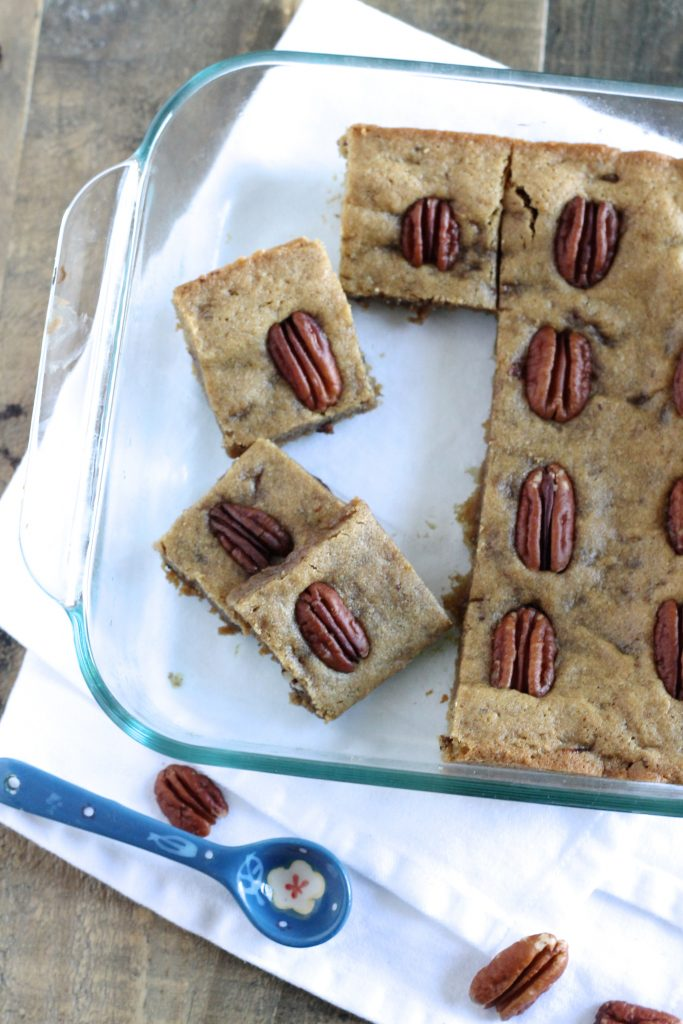 These Whole Wheat Blondies with Pecans are a healthier alternative to the traditional butter-packed blondie bar. The whole wheat flour adds fiber and the pecans add a healthy fat to these delicious and addicting dessert bars. A great bake sale or lunch box treat for the kids! ll www.littlechefbigappetite.com