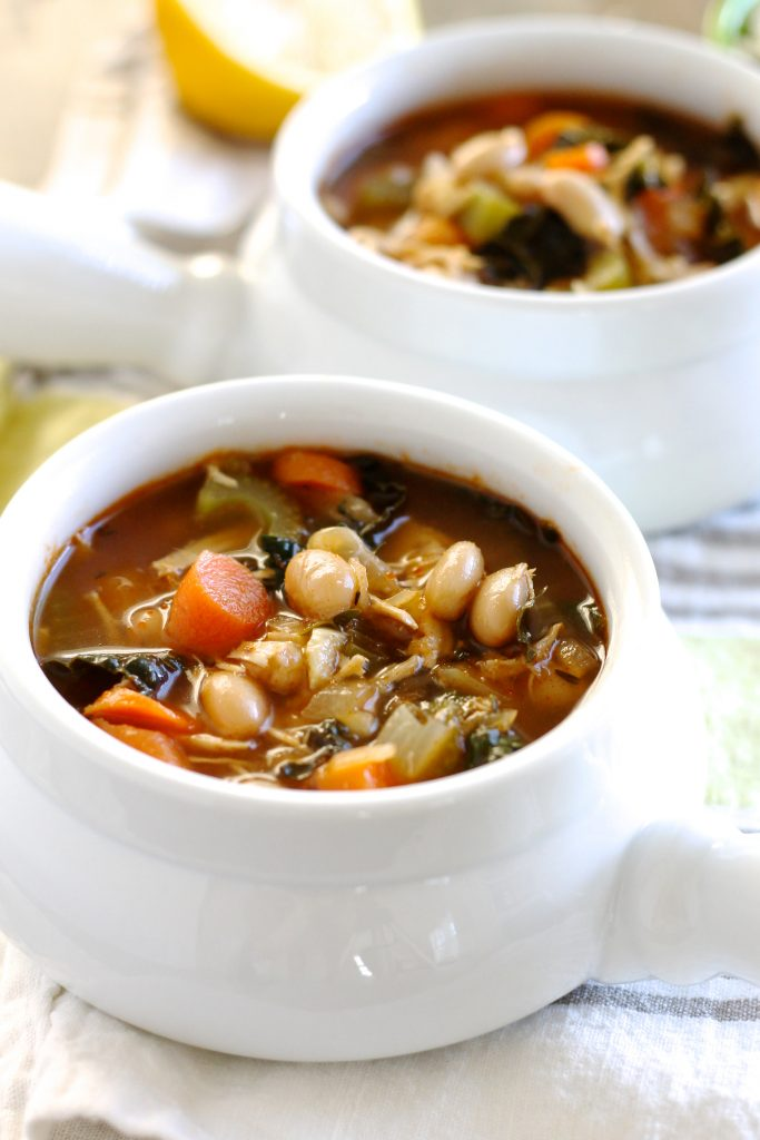 This Tuscan White Bean Soup with Chicken is a delicious hearty meal on a chilly night! Made with carrots, celery, and white beans, this soup is healthy, gluten-free, and even vegan optional if you leave out the chicken. Plus, you'll have it on the table in 30 minutes! ll www.littlechefbigappetite.com