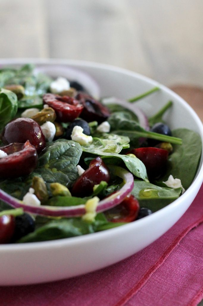 Spinach Salad with Cherries, Goat Cheese, and Pistachios is a summertime crowd pleaser! Even your pickiest eaters will love the combination of sweet and tangy in this delicious and healthy salad. ll www.littlechefbigappetite.com