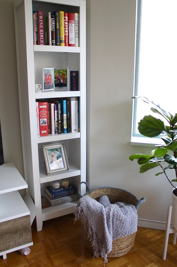 White Bookcase with books and frames