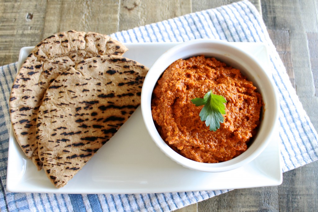 Muhammara Roasted Red Pepper Dip in a White Serving Bowl with Whole Wheat Pita | www.littlechefbigappetite.com
