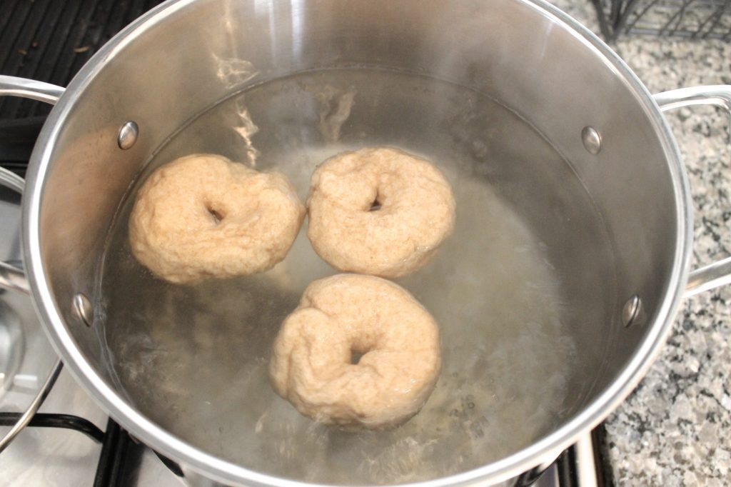 Boiling Homemade Whole Wheat Bagels | www.littlechefbigappetite.com