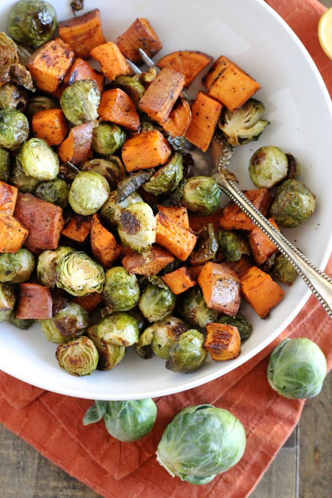 You have to try this Maple Roasted Brussels Sprouts and Sweet Potatoes Recipe! It's such a simple, yet delicious fall and winter side dish. It would be perfect on your Thanksgiving table! ll www.littlechefbigappetite.com