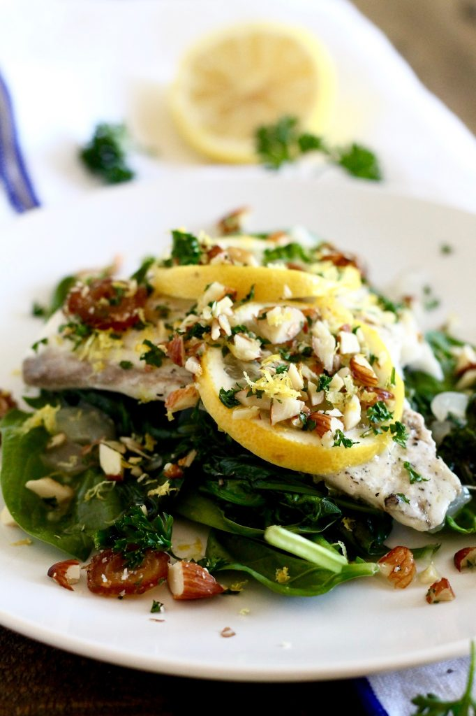 Barramundi in Parchment with Lemons, Dates and Toasted Almonds ll A delicious, healthy, gluten-free weeknight dinner that comes together in under 25 minutes! ll www.littlechefbigappetite.com